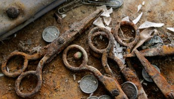 Rusted scissors, coins and other debris sit on the floor of an elementary school in the Lakeview neighborhood of New Orleans, La. File Photo.