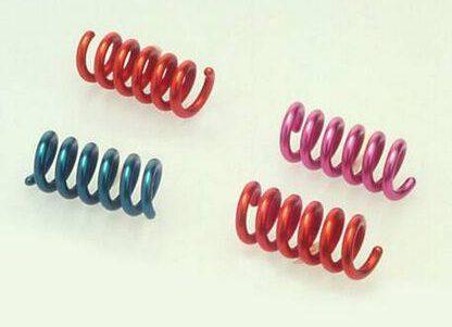 Paul Derrez, Spiraal broche, ontwerp 1976, uitvoering 1986. Collectie Design Museum Den Bosch, geanodiseerd aluminium