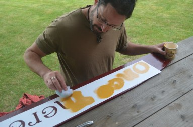 Tom stenciling the crownboard lettering