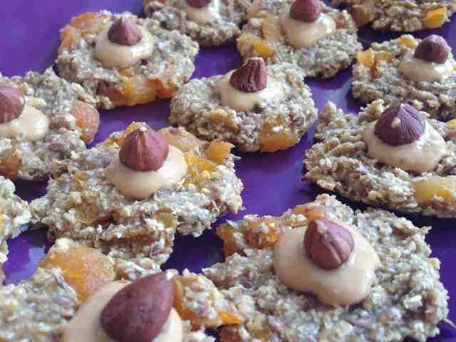Banana Oatmeal cookies with dried apricots, topped up with peanut butte and hazelnuts
