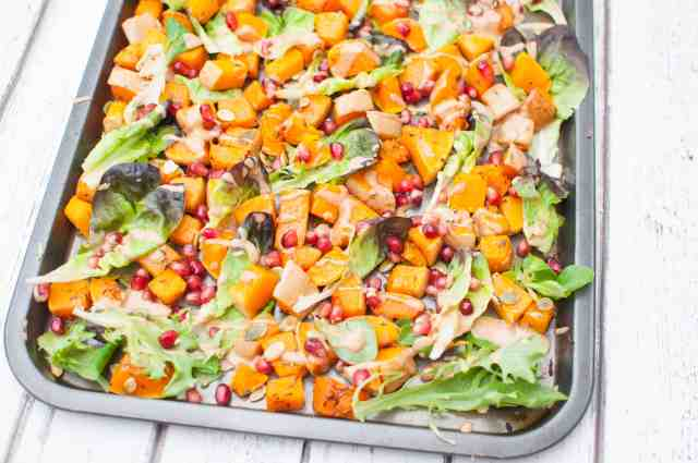 This delicious clean eating butternut squash salad recipe is made with pomegranate, pumpkin seeds, crispy salad leaves and insanely good almond butter dressing #dairyfree #glutenfree #vegan #vegetarian