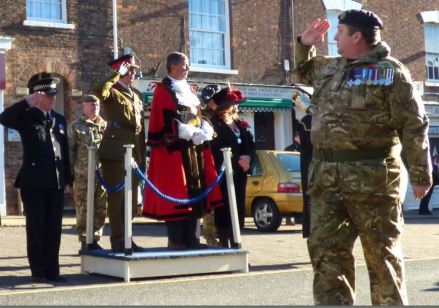 Major Fred Owen leads the formal salute
