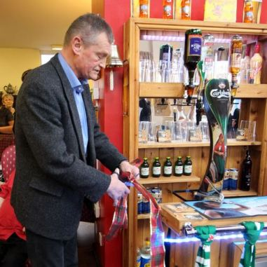 Phil cuts the ribbon - The Bar is open!