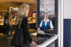Corinna Born in front of an InfoGate - At the InfoGate, the airport visitor simply pushes a button to be connected immediately with an information service representative for a real-time video dialogue on life-sized screens., Munich Airport, shot on 04/30/2015 Photo: Stephan Goerlich