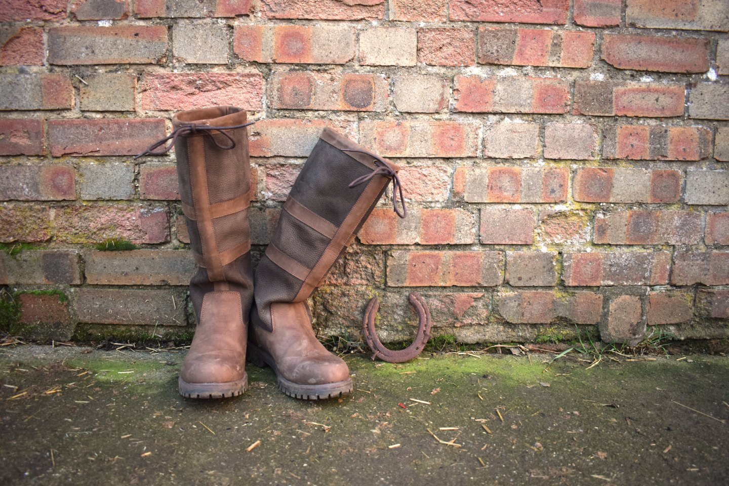 Rydale Tullymore II boots against a brick wall