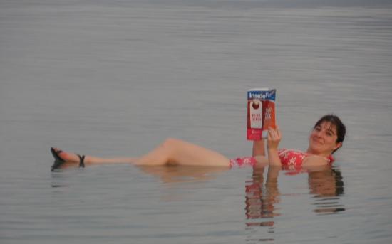 Keri Heels First Travel floating in Dead Sea