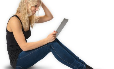 frustrated woman on ipad