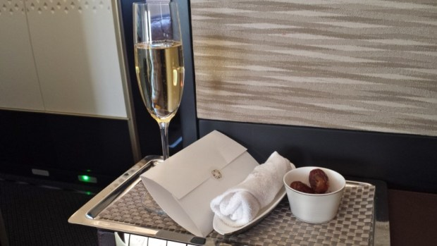 Etihad A380 First Apartment JFK-AUH inaugural welcome note towel champagne
