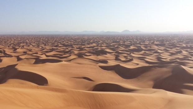 Al Maha Resort Dunes Dubai in distance