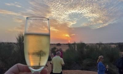 Al maha desert resort camel ride champagne sunset