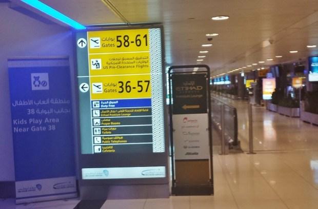 etihad premium lounge abu dhabi terminal 3 signage