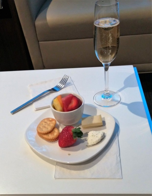 LAX Star Alliance First Class Lounge cheese champagne