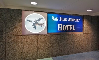 San Juan Airport Hotel Review sign