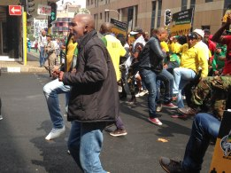 MOVING FORWARD: ANCYL members marched through the streets of Johannesburg from the Nelson Mandela Bridge to the Yoeville recreational centre on April 24th 2015. The marchers sang and toyi-toyied through the streets in solidarity against the recent xenophobic attacks. Photo: Tanisha Heiberg