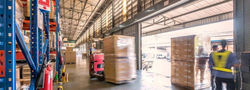 Forklift driver transporting crates.