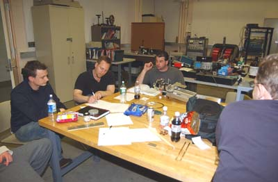 Fig.11 Cyclotron staff, visitors, and students working together to design new 2-D magnetic field mapper.