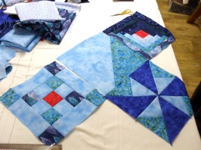 individual blocks laid out, with the central block waiting to have the boat appliquéd on.