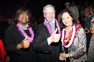 Roger Ebert and his wife Chaz with Nancy Kwan