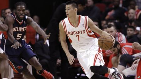 Houston Rockets' Jeremy Lin (7) drives the ball around Atlanta Hawks' DeMarre Carroll (5) in the first quarter of an NBA basketball game on Nov. 27, 2013 in Houston, Texas.