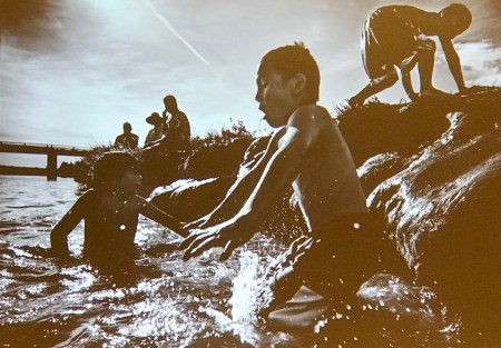 Richard Tsong-Taatrii photographed kids playing in the water while covering the Standing Rock protest.