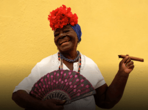 Cuban_Woman_in_Havana_Cuba_Coloful_Backdrop_and_Fan