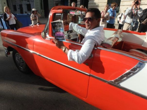 Classic_red-convertible_and_book_Cubicle_to_Cuba_in_Havana_Cuba_by_Heidi_Siefkas