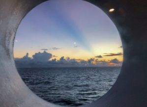 Sunset_from_Carnival_Paradise_Port_Hole_Off_the_Coast_of_Cuba