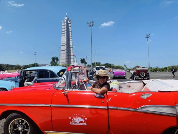 Author_Heidi_Siefkas_in_Classic_Chevy_Belair_in_Revolution_Square_Havana_Cuba