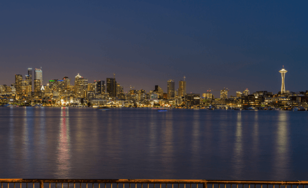 View of the Seattle skyline at night as seen from across Lake Union