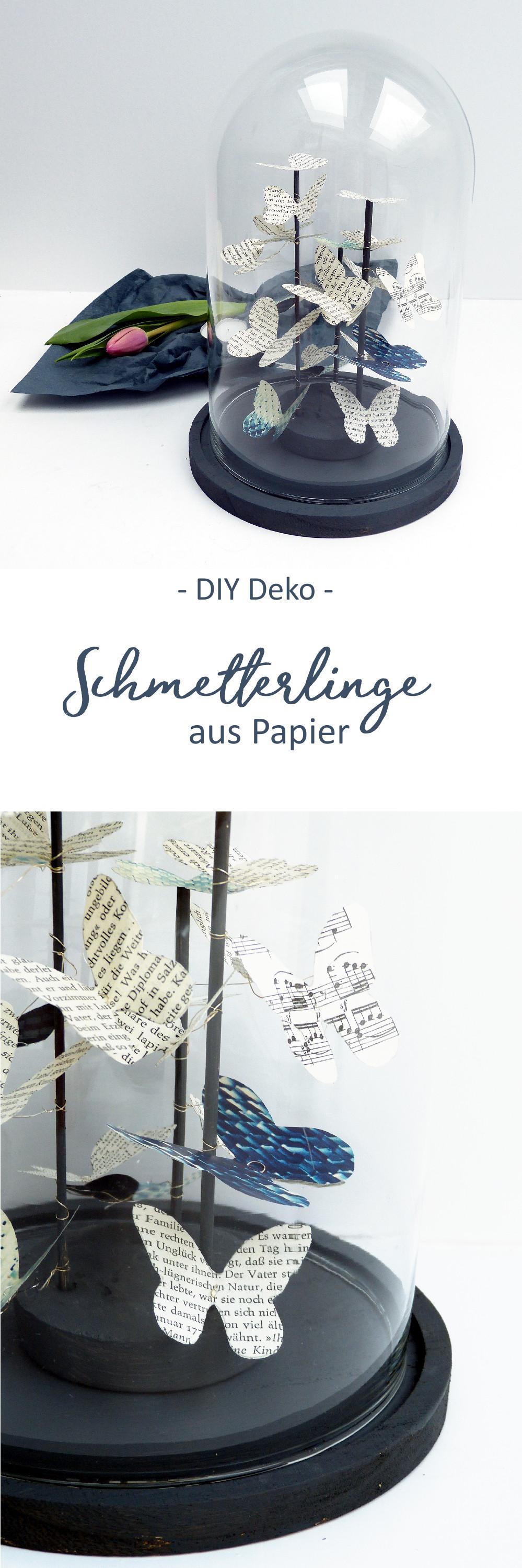 Schmetterlinge aus Papier als Schwarm in einer Glaskuppel. DIY Anleitung mit Vorlage zum Ausdrucken.