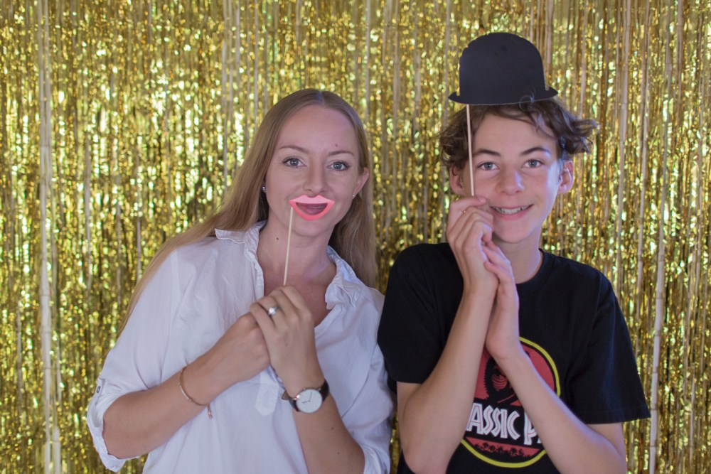 Gold foil photo backdrop and props at movie-themed party