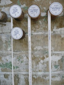 Ribbons hanging down from the reels are embroidered with the names of the workers' children