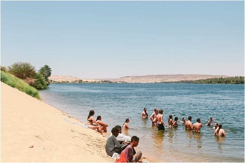 at the beach along the nile river with travel talk tour