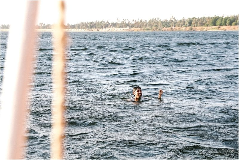 man swimming in nile river with Travel Talk Tours Felucca Odyssey