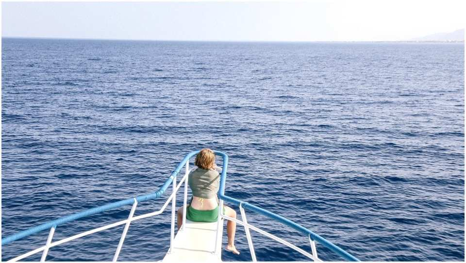 girl on a boat trip along the Red Sea Egypt Dahab