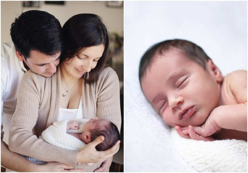 new parents holding and smiling their newborn baby photographed by Connecticut photographer