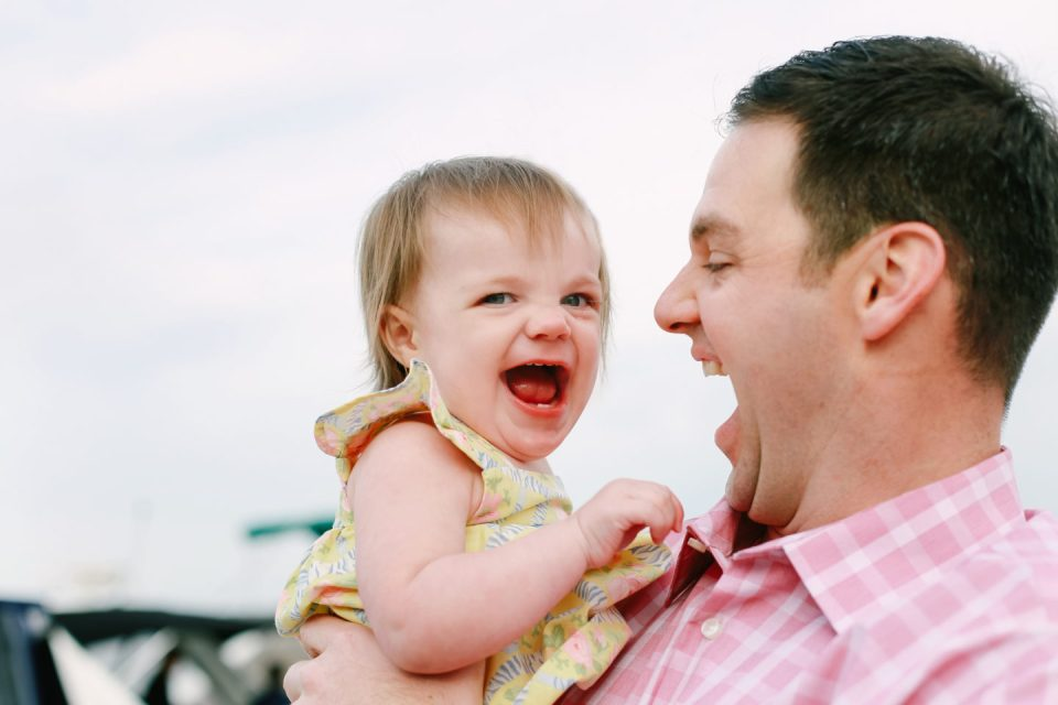 baby girl and dad laughing in Connecticut with family photographer