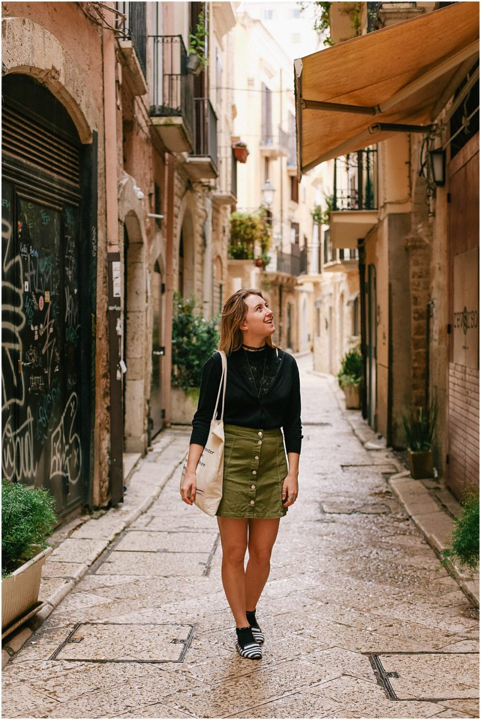 Helena Woods photographer walking in Bari's Old Town in Puglia Italy