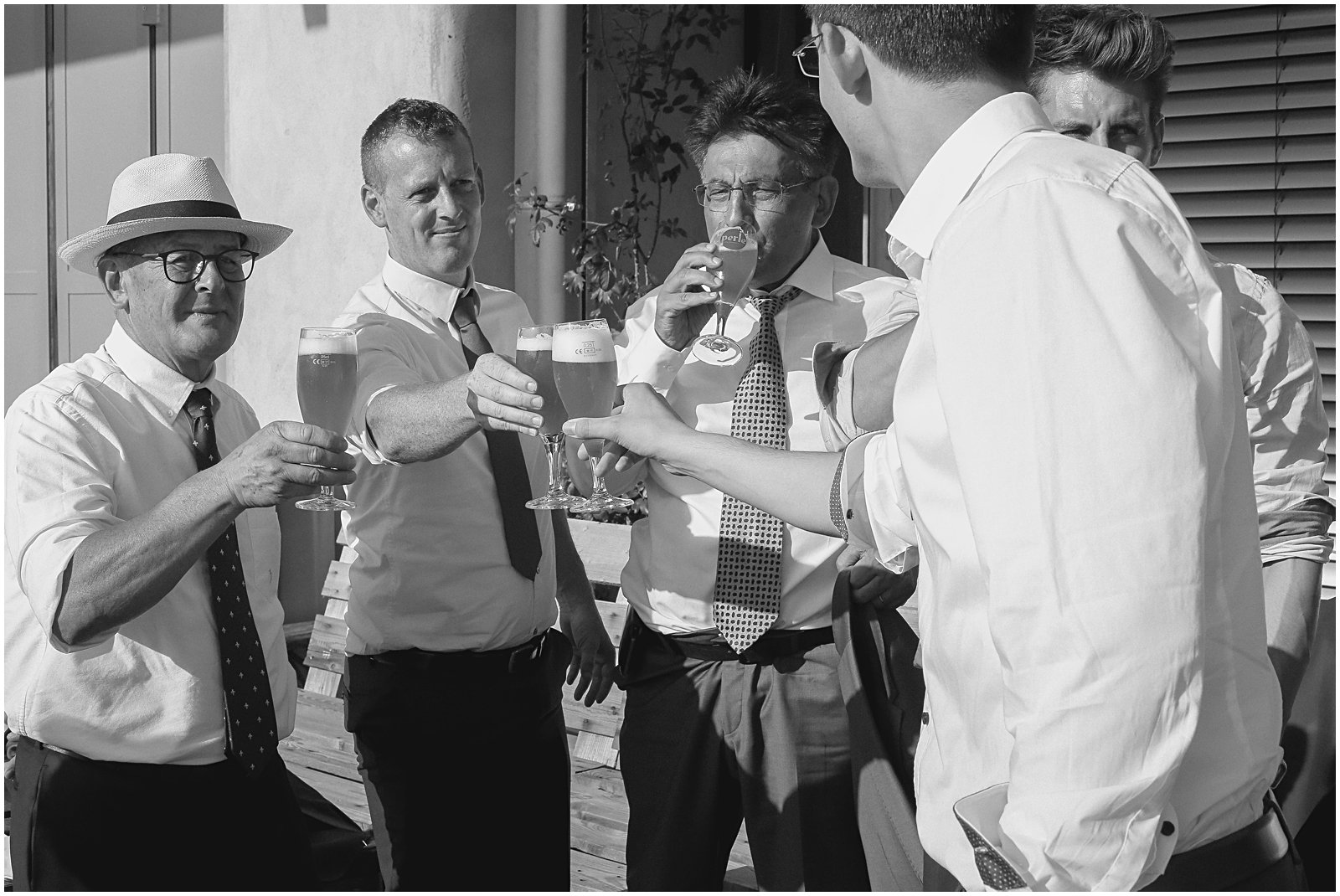 groomsmen drinking at wedding reception photographed by Helena Woods