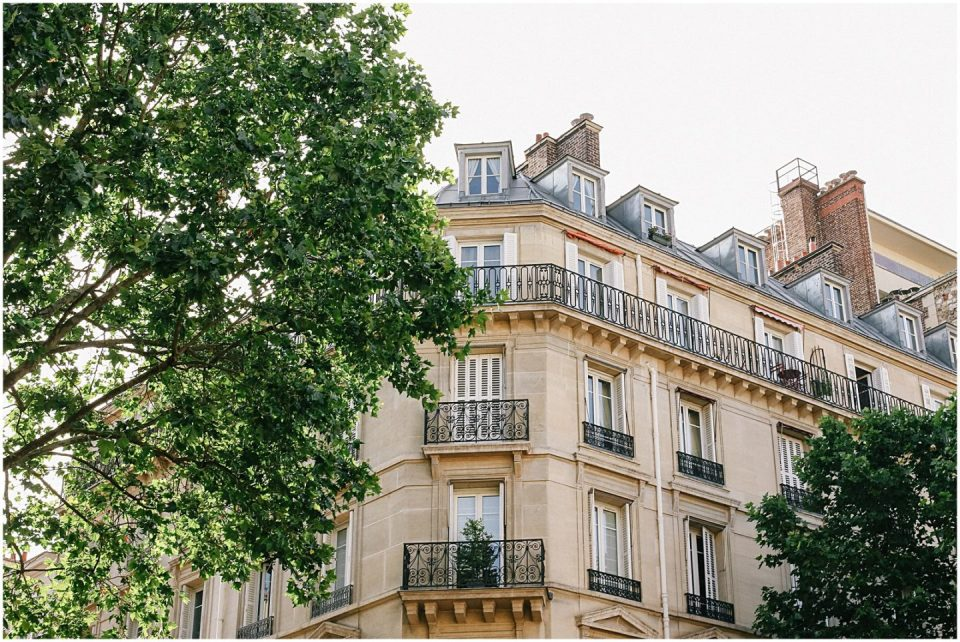 expat wife looking at building in Paris, France