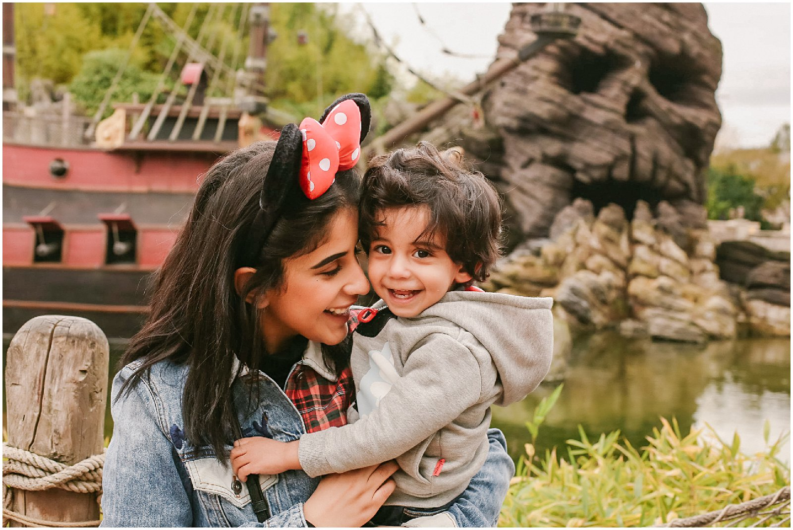 mother and son laughing with photographer at Disneyland Paris