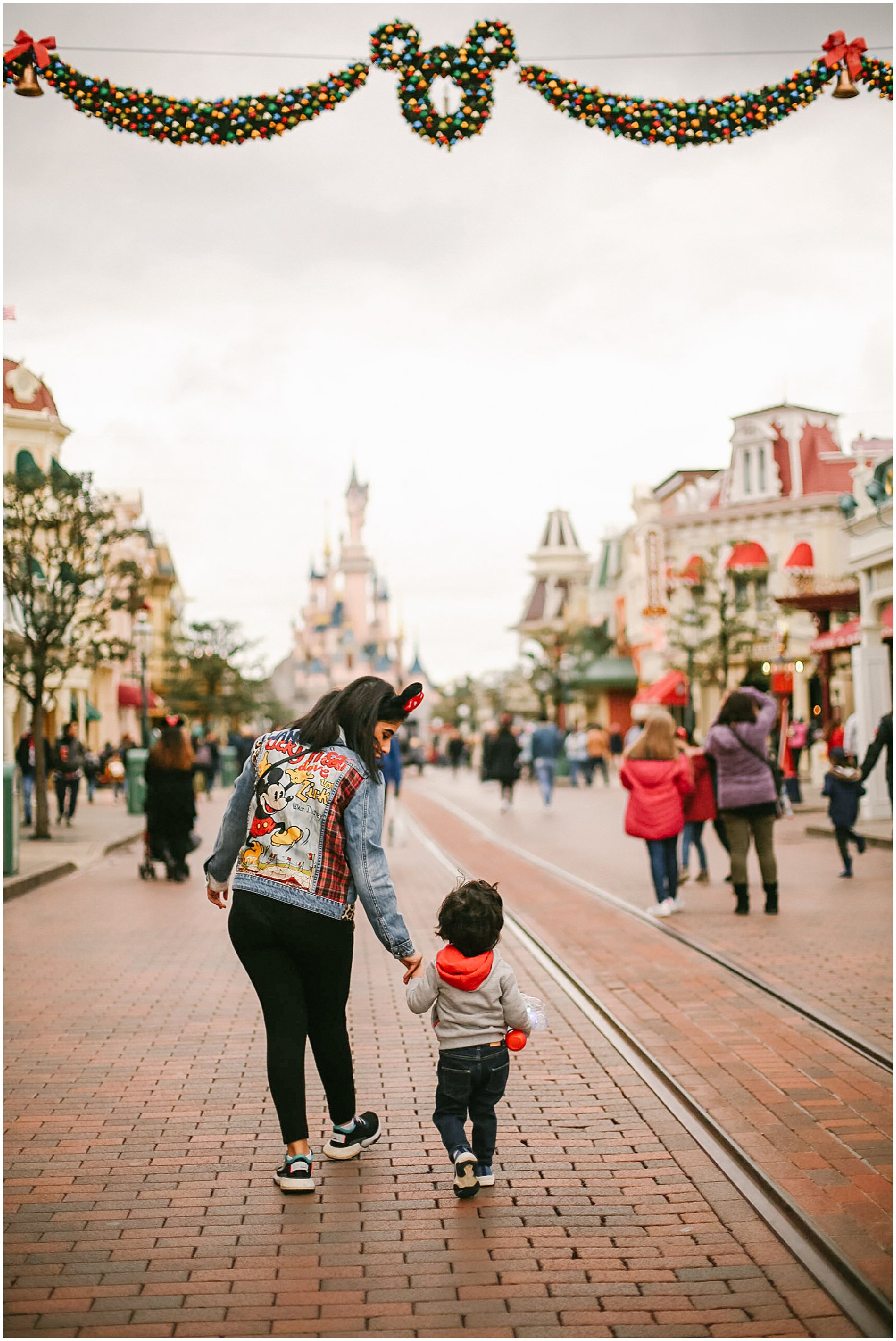 mother and son on Main Street photographed at Disneyland Paris with France photographer helena woods
