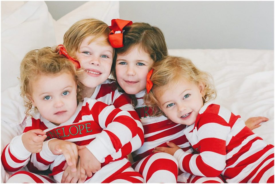 children dresses in matching christmas pajamas at home with lifestyle family photographer Helena Woods