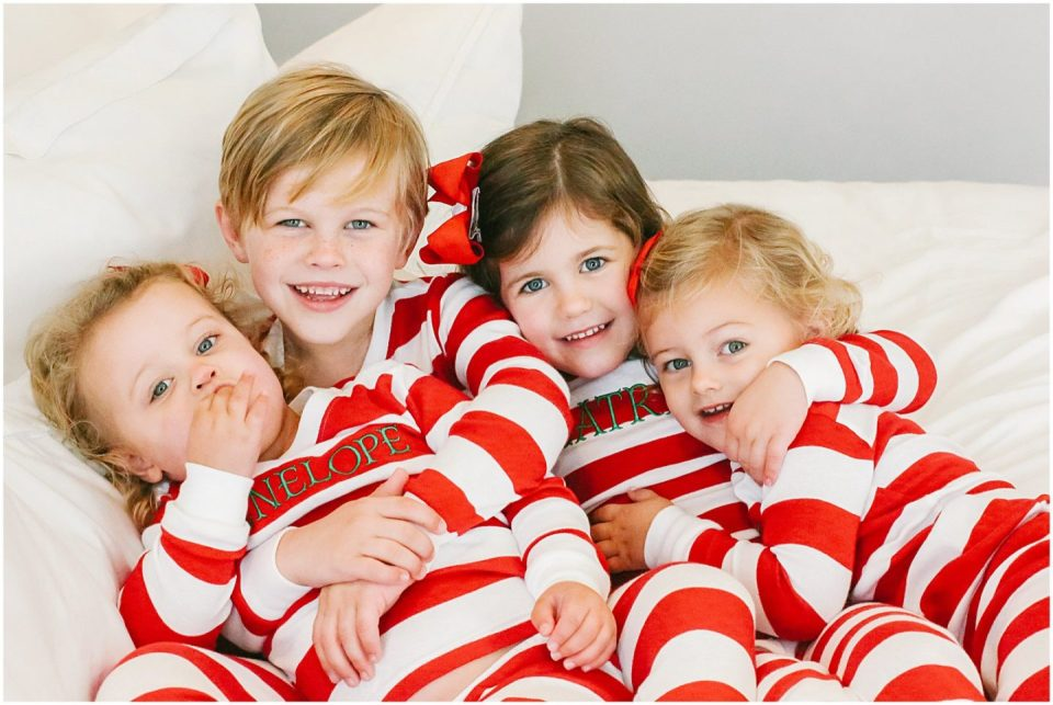 children matching christmas pajamas at home with lifestyle family photographer Helena Woods