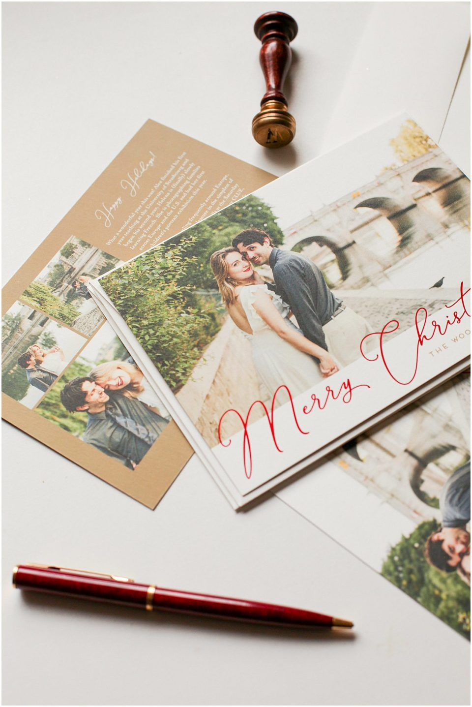 flat lay of print Christmas card of family with Helena Woods Photography
