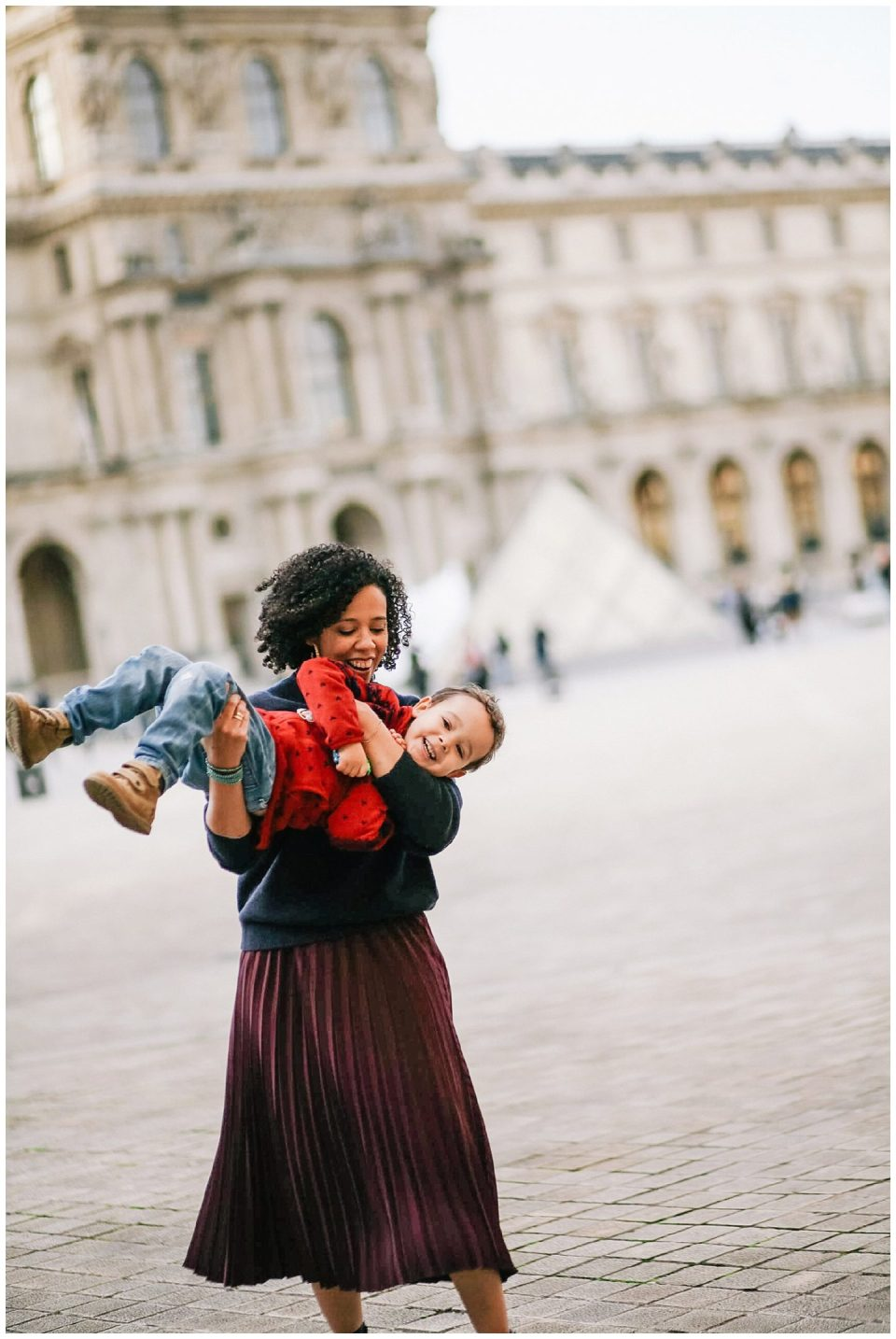 Paris family photographer photographs mother and son at Louvre