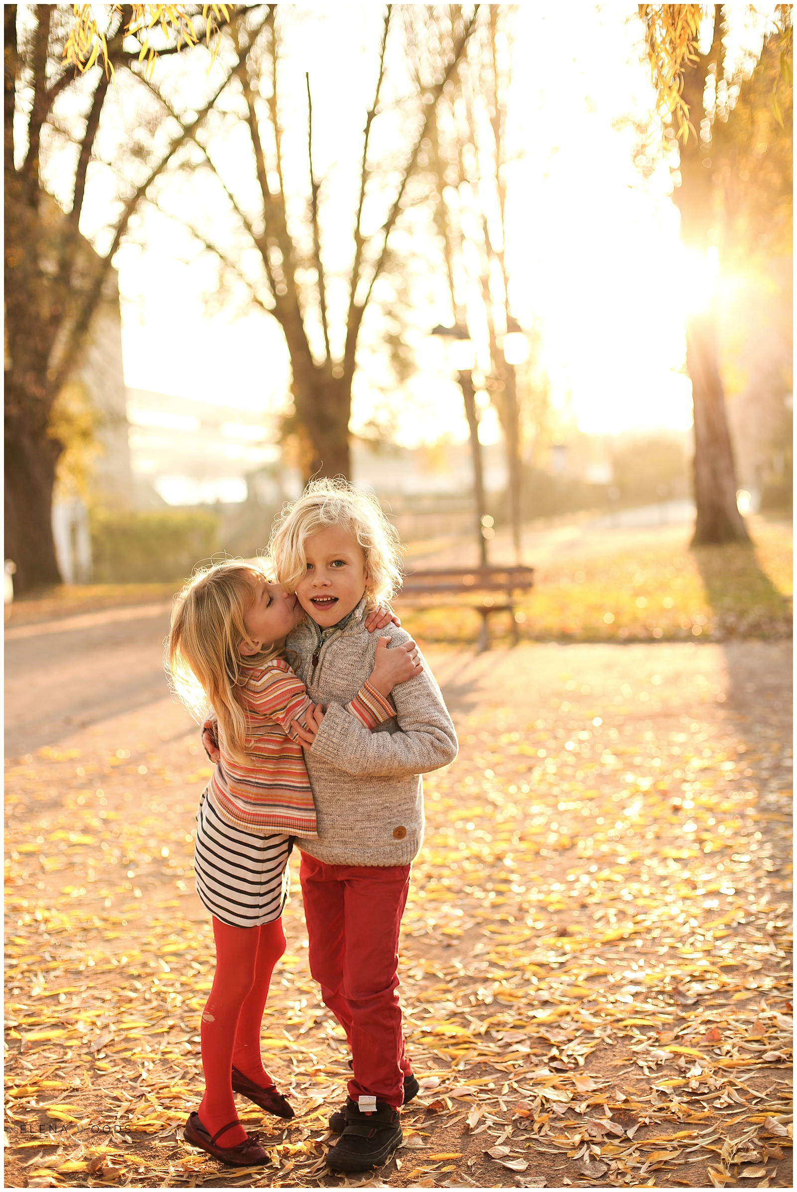 kids laughing in Strasbourg France at golden hour with family photographer Helena Woods