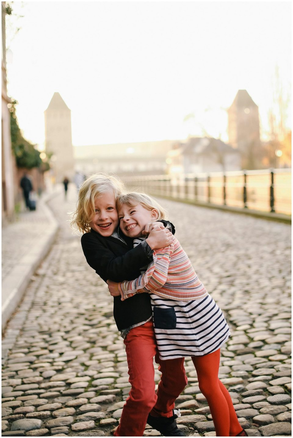 sibling kids hugging with Strasbourg France Alsace family vacation photographer | Helena Woods Photography