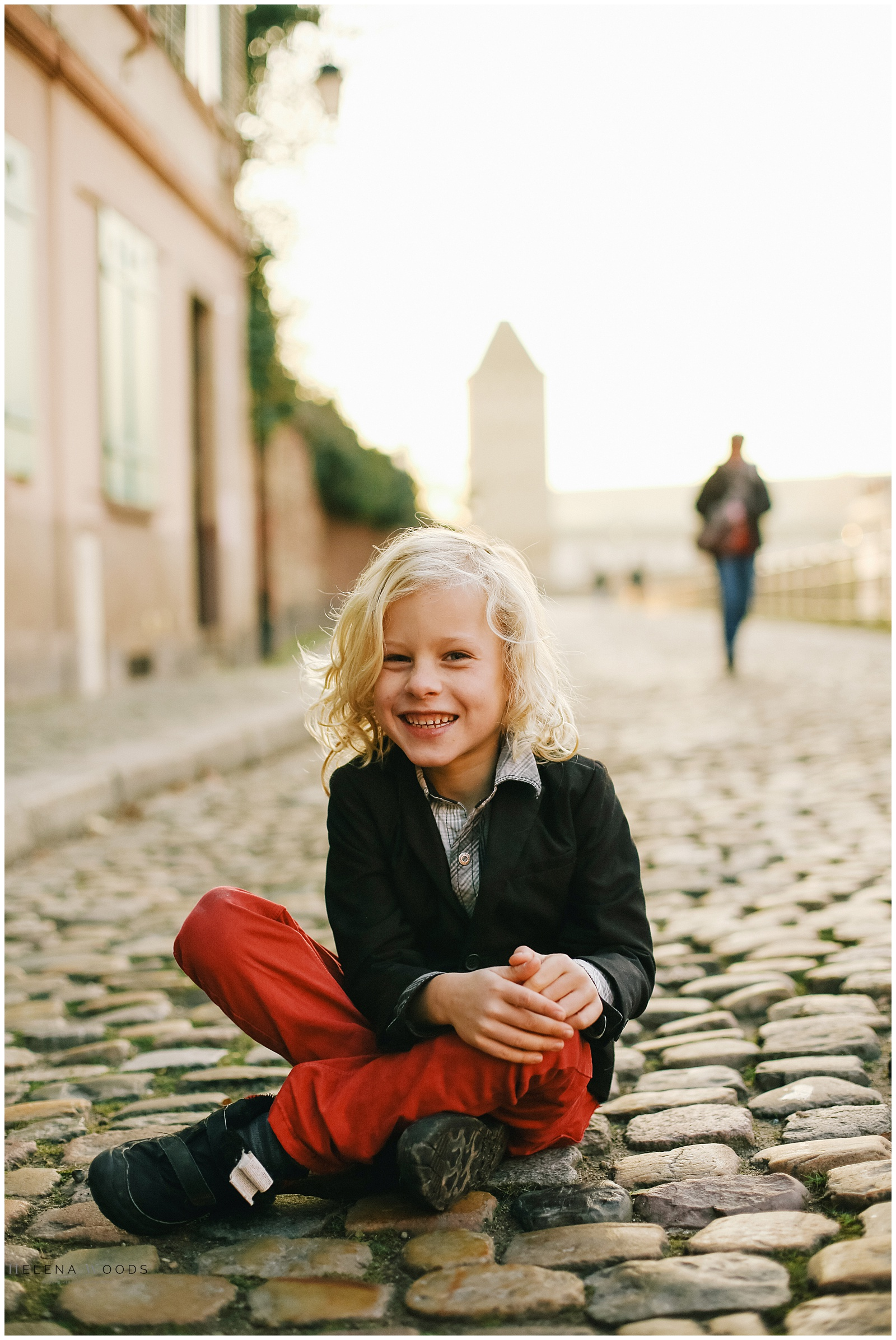 boy posing for photographer in Strasbourg Alsace France | Helena Woods Photographer