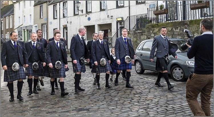Scotsmen in tartan kilts